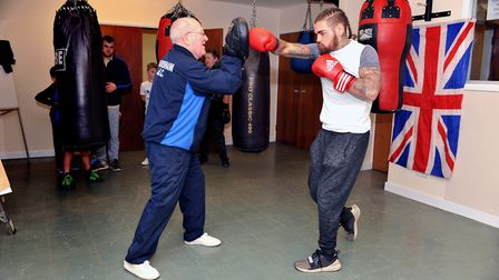 Tyler Goodjohn in training with his coach Mike Sawyer Picture: KATH SANSOM