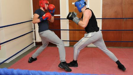 Tyler Goodjohn, in the ring with a member of Haddenham Boxing Club. He has switched from pro to bare