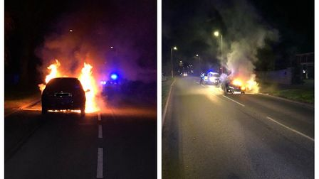 Shocking images show the car after it burst into flames near Peterborough after driving down the A1