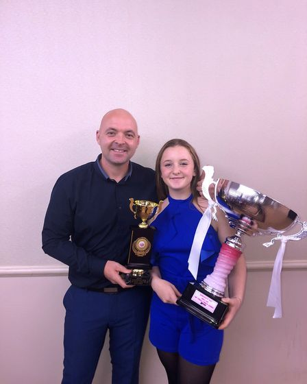 Dunmow's Katie Stock with dad Simon and two of her trophies