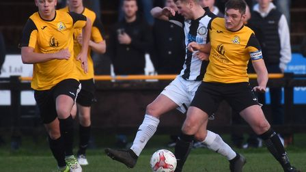 Captain Max Mattless wins the ball for March Town during their victory against Swaffham. Picture: IA