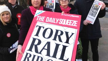 MEP Alex Mayer with commuters protesting the rail price hike.