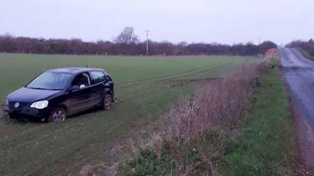 Volkswagen Polo ends up in Isleham field but no one was injured. Picture: BCH ROAD POLICING
