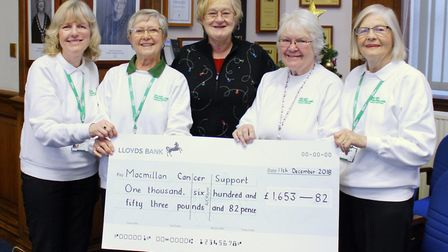 Christmas came early at Fenland Hall in March as more than £1,600 was donated to Macmillan Cancer Su