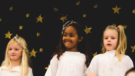 KS1 pupils at Thaxted Primary School perform in navitiy, Whoops-a-Daisy Angel. Picture: SOPHIE OLDHA