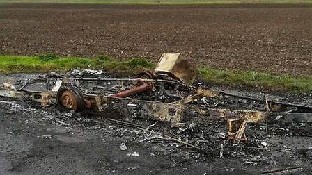 The burnt out remains of the caravan which was torched by suspected arsonists on Dykemoor Drove in D