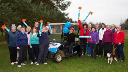New Tydd St Giles women's captain Liz Miller (sitting on buggy) surrounded by members at her Drive I