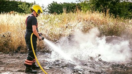 Cambs Fire and Rescue battle a blaze in the hot weather.
