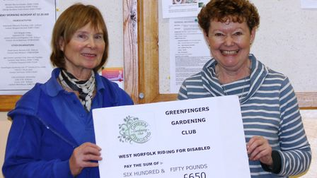 Susie Haynes (right) of the Greenfingers Gardening Club presenting Rosie O'Grady (left) of the Magpi