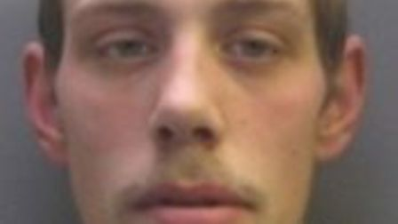 Ryan Darby (pictured) is wanted by police in connection with a knife-point robbery in Cambridge. Pic