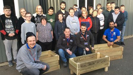Students and members of the Volunteer It Yourself team from Wickes at Meadowgate Academy, Wisbech. P