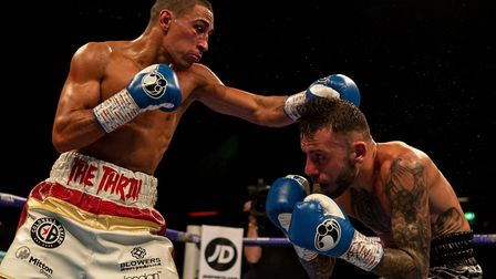 Jordan Gill on his way to Commonwealth featherweight title glory against Ryan Doyle. Picture: PAUL H
