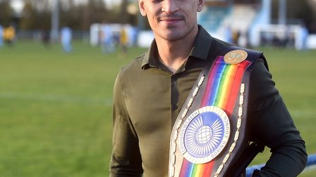 Jordan Gill showing off his Commonwealth featherweight title during a visit to Chatteris Town FC las