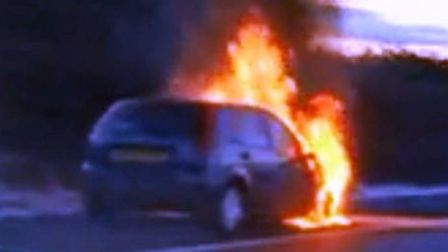 The car which burst into flames on the A11 slip road from the M11 during rush hour on Wednesday, Jan