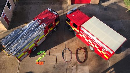 Cambridgeshire firefighters celebrating hitting 2,500 followers on Instagram in the most creative wa