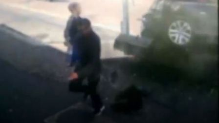 Shocking footage has emerged of a dangerous driver narrowly missing a father and his baby son in a d