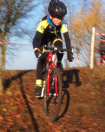 Tom Lewis tackles a technical descent in the U12s race (pic Martin Lewis)