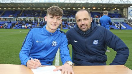 Harrison Burrows of Wisbech signs a contract with POSH. Picture: POSH