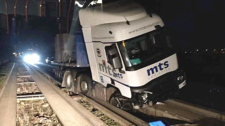 A large haulage lorry was photographed after it crashed while driving on Cambridgeshire's guided bus