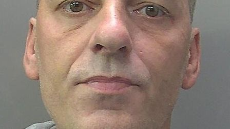 A burglar who was caught red handed by a startled homeowner has been jailed for a year. Michael Hutc