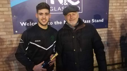 Callum Russell receives his man-of-the-match award from sponsor Nick Flack of N & C Glass after hitt