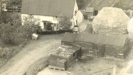 Pond Farm house, timber barn and corn stack in background. Corrugated iron roof was put on in 1900's