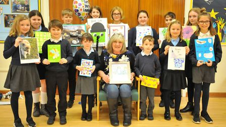 The special assembly held for Marilyn Simpson (centre) who has worked at Cavalry Primary School in M