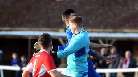 Ely City goalkeeper Harry Reynolds uses his head against Histon. Picture: IAN CARTER