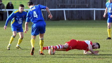 Sam Goodge hits the deck but keeps hold of the ball for Ely City against Histon. Picture: IAN CARTER