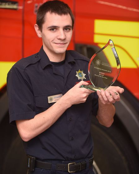 March firefighter Jordan Sutton with his award. Picture: IAN CARTER.
