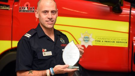 March fire station crew commander Wayne Marshall with his award. Picture: IAN CARTER.