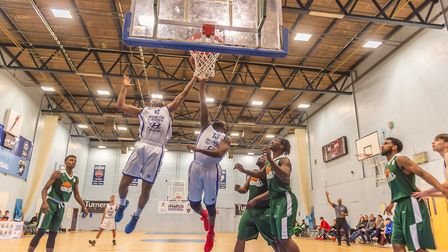 Veron Eze and M. Isebor go fo tthe offencive rebound to get the 2 points Photo: PAVEL KRICKA
