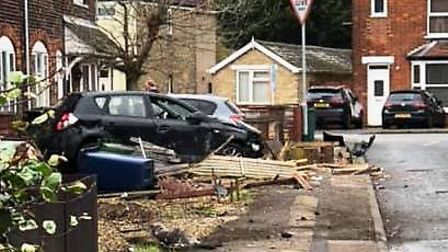 The scene on Norwood Road after a driver ploughed through residents' gardens in their black hatchbac
