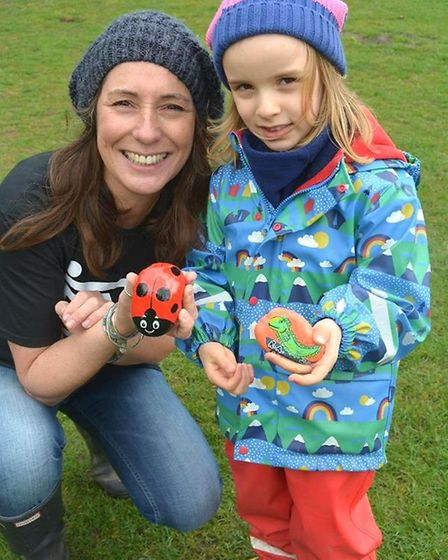 Fleur Patten with some of her painted rocks, attends the Skate park campaign day in Ely. Picture: MI