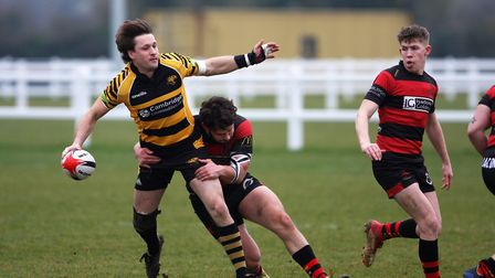 Tom Jackson looks to unload the ball. Picture: STEVE WELLS