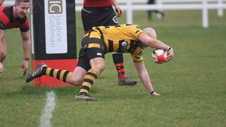 Charlie Coupland touches down for a Tigers try. Picture: STEVE WELLS