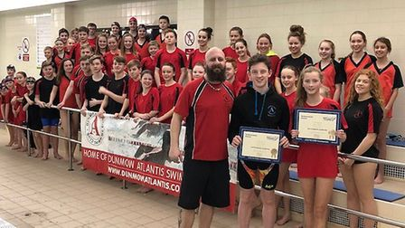 Dunmow Atlantis Swimming Club youngsters Sam Dack and Rebecca Johnson receive their Jack Petchey awa