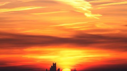 The sun rises behind Ely Cathedral in Cambridgeshire. The cathedral remains our principal tourism at