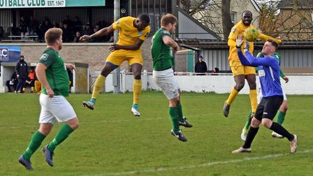 Soham defenders Lee Chaffey and Lloyd Groves, and goalkeeper Craig Foxhall, can't prevent Barking's