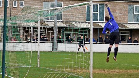 Soham goalkeeper Craig Foxall gets off the ground last Saturday. Picture: TERRY GILBERT