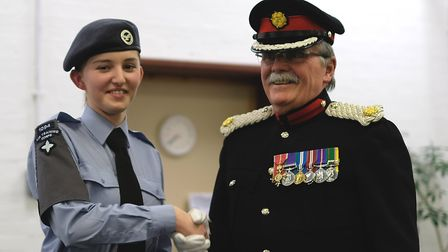 Air cadet Saoirse McNeil (pictured left) with Roger Herriot OBE after her promotion at the Ely Air C