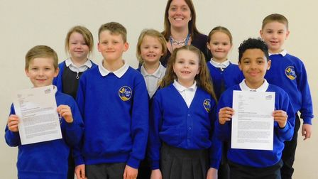 Head teacher Jane Segust with some of her pupils at The Shade Primary School, Soham. An inspection v