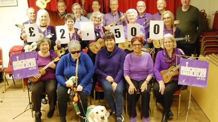 Rocking Ukuleles of Ely present cheque to Dogs For Good charity. Picture: ROCKING UKULELES.