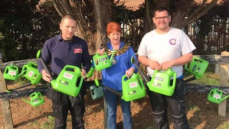 Mayor Councillor Jan French with watering cans donated to Eastwood Road cemetery. Picture: JAN FREN