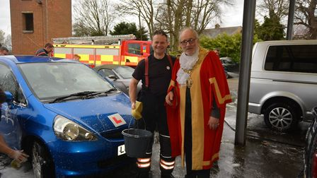 Soapy suds helped firefighters in Ely raise money for charity while they gave up their Saturday to w
