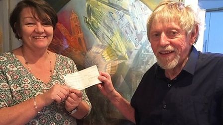 Caroline Cawley from Babylon Arts receives a donation for £300 towards the charity's work from Ted C