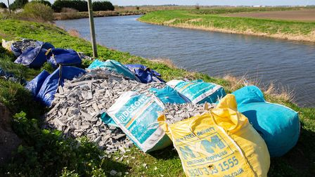 Flytippers dump 12 x 1 ton bags of asbestos near river.,B1098, Chatteris Monday 25 March 2019. Pictu