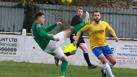 Soham Town Rangers man Lewis Endacott gets a leg up against Canvey Island! Picture: ROBERT CAMPION