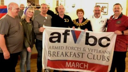 Veterans tuck in to cooked breakfast for first club meeting in March. Mayor of March Jan French also