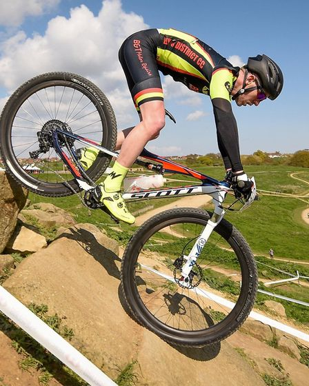 Mikie Burrell riding one of the technical features of the Olympic MTB course. Credit Richard Howes